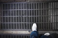 Foot on drain Stock Photos