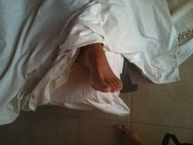Foot and Drapery Stock Photography