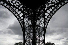 Foot of the eiffel tower ongrey cloud stock image