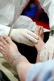 Foot Examination. Podiatrist doing a foot examination on diabetic patient Royalty Free Stock Photography