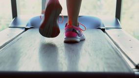 Foot runner on a treadmill, close-up stock video