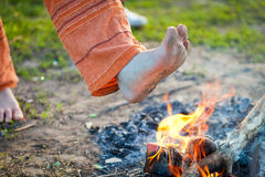 Foot in the fire Stock Images
