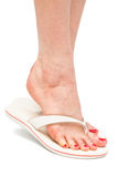 A foot in flip-flops Stock Images