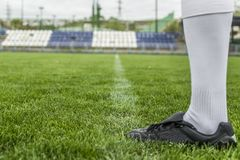 Soccer player in boots at the football stadium. Foot in a football boot on the football field. Euro 2018 Championships Royalty Free Stock Photo