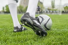 Soccer player in boots at the football stadium. Foot in a football boot on the football field. Euro 2018 Championships Royalty Free Stock Image