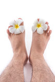 of the foot with frangipani flower in spa. The  of the foot with frangipani flower in spa on white background Stock Image