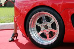 Kiev, Ukraine - July 1, 2012; Foot of the girl and the car wheels. Speed. Supercar stock image
