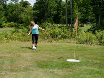 Foot Golf Putt. A young lady putts a soccer ball on a foot golf green Stock Photo