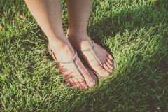 Foot on Grass Stock Image