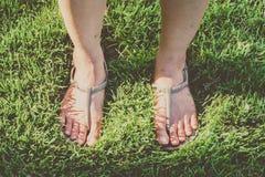 Foot on Grass Stock Photos