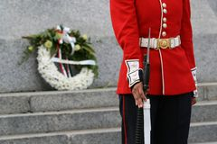 Foot Guard with Memorial Wreath. A Ceremonial Guard stands at the National War Memorial in Ottawa, Ontario, Canada royalty free stock photo