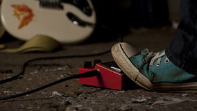Foot on guitar dither (effect box) Royalty Free Stock Photo