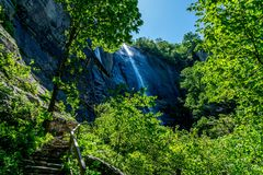 404 Foot Hickory Nut Falls. The 404 foot Hickory Nut Falls in Chimney Rock State Park, North Carolina royalty free stock photography