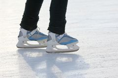 Foot ice-skating person on the ice rink royalty free stock photography
