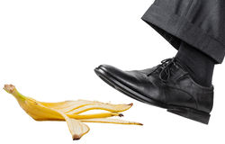 Free Foot In The Left Black Shoe Slips On A Banana Peel Royalty Free Stock Image - 65140136