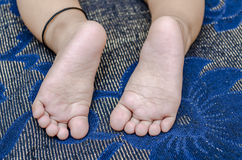 Tiny feet of infant baby boy Stock Images