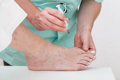 Foot injection Stock Image
