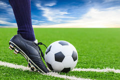 Foot kicking soccer ball Royalty Free Stock Photos