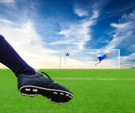 Foot kicking soccer ball Royalty Free Stock Images