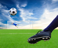 Foot kicking soccer ball Stock Images