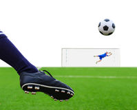 Foot kicking soccer ball  Royalty Free Stock Photography