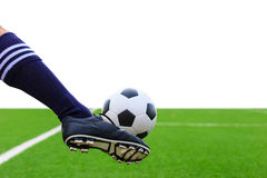 Foot kicking soccer ball isolated Stock Images