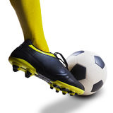 Foot kicking soccer ball isolated Royalty Free Stock Images