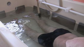 Foot and leg water jet massage stock footage