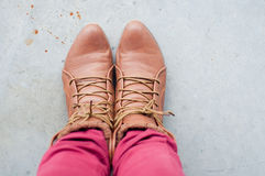 Foot and legs seen from above. Selfie. Woman boots Stock Photos