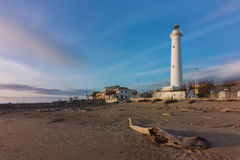 At the foot of the lighthouse on the beach of Punta Secca. A wintry wide view of the beach in Punta Secca, the immaginary city where the Commissario Montalbano Stock Photography