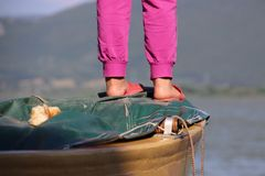 Foot of the little girl on the boat Royalty Free Stock Photography