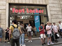 Foot Locker shoe store. A group of young people in front of Foot Locker shoe store stock photography