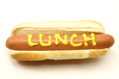 Foot Long Hot Dog with Lunch written in mustard Royalty Free Stock Photo
