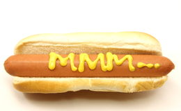 Foot Long Hot Dog with MMM... written in mustard. Royalty Free Stock Image