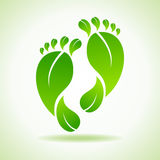 Foot made by green leaves Stock Photos