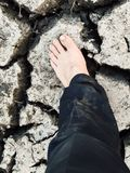 Foot man on crack soil Royalty Free Stock Photography