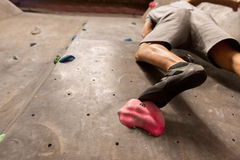 Foot of man exercising at indoor climbing gym Royalty Free Stock Photography