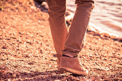 Foot man walking outdoor on beach trendy style. Melancholy concept Stock Photography