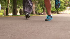 Foot of marathon runners. On the road stock footage