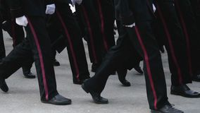 Foot on the March of the Military. A close-up of the feet of military men who march on the parade on May 9, 2018 in a slow motion shot. Same clothes and shoes stock video footage