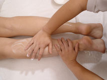 Foot massage. Portrait of a young girl enjoying a healthy skin treatment at a spa resort Royalty Free Stock Photo