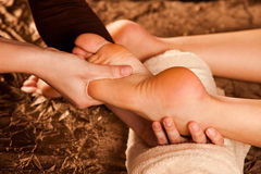 Foot massage. Technique close up Royalty Free Stock Photo