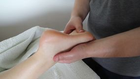 Foot massage. In beauty salon, close up view. Woman having sports  in spa salon. Male masseur therapist hands doing on female . Professional masseuse massaging stock video