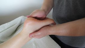 Foot massage. In beauty salon, close up view. Woman having sports  in spa salon. Male masseur therapist hands doing on female . Professional masseuse massaging stock footage