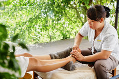 Foot Massage. Body Skin Care. Masseur Massaging Feet. Spa Treatment Royalty Free Stock Images