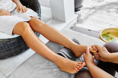 Foot Massage. Body Skin Care. Masseur Massaging Feet. Spa Treatment Royalty Free Stock Photography