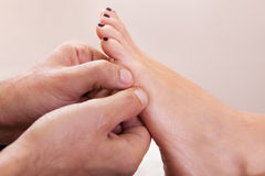 Foot massage close-up Royalty Free Stock Photos