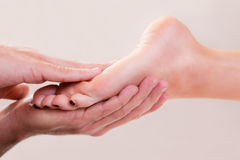 Foot massage close-up Royalty Free Stock Images