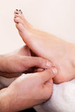 Foot massage close-up Stock Photography