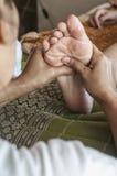 Foot massage close up shot Stock Photo